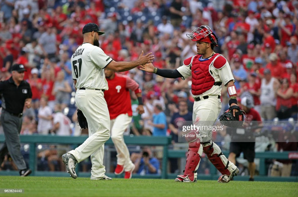 Luis Garcia #57 of the Philadelphia Phillies is congratulated by Jorge Alfaro #38 after saving a game against the Toronto Blue Jays at Citizens Bank Park on May 26, 2018 in Philadelphia, Pennsylvania. The Phillies won 2-1.