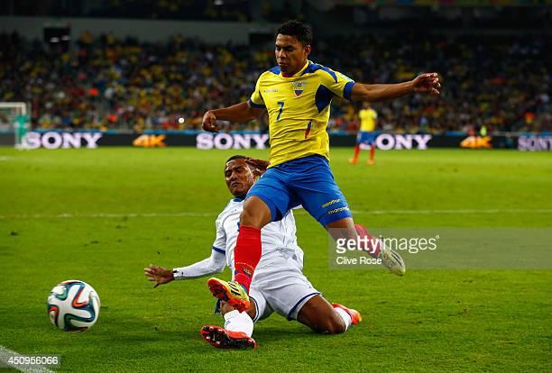 Luis Garrido of Honduras tackles Jefferson Montero of Ecuador during the 2014 FIFA World Cup Brazil Group E match between Honduras and Ecuador at...