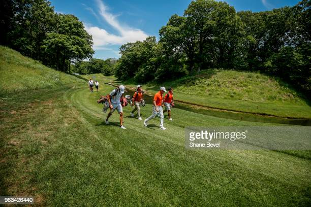Luis Garza of Arkansas Doug Ghim of Texas and Bryson Nimmer of Clemson make their way down the third fairway during the Division I Men's Golf...