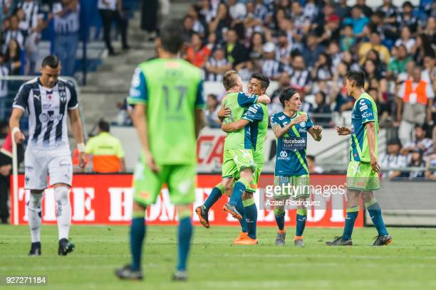 Luis Gerardo Venegas of Puebla celebrates with teammates after scoring his team's second goal during the 10th round match between Monterrey and...