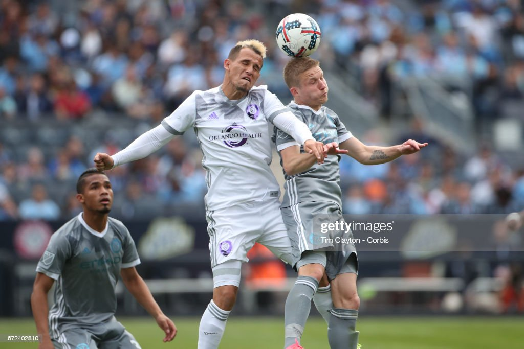 Luis Gil #17 of Orlando City SC is challenged by Alexander Ring #8 of New York City FC during the New York City FC Vs Orlando City SC regular season MLS game at Yankee Stadium on April 23, 2017 in New York City.