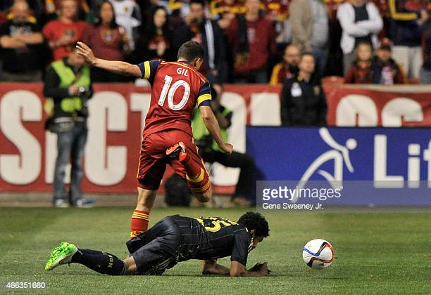 Luis Gil of Real Salt Lake leaps over Sheanon Williams of the Philadelphia Union in the first half at Rio Tinto Stadium on March 14 2015 in Sandy Utah