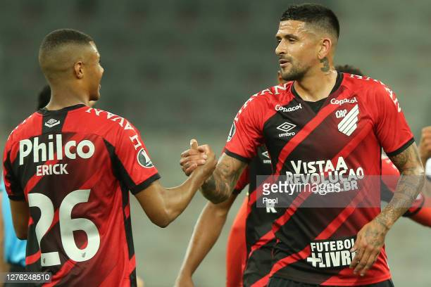 Luis Gonzalez greets Erick of Athletico Paranaense after their victory in a group C match of Copa CONMEBOL Libertadores 2020 against ColoColo at...