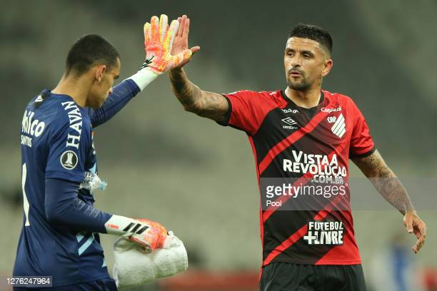 Luis Gonzalez greets Santos of Athletico Paranaense after their victory in a group C match of Copa CONMEBOL Libertadores 2020 against ColoColo at...
