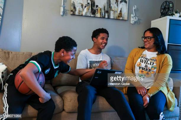 Luis Gonzalez left laughs with his brother Garvy Gonzalez and their mom Luisa Marcano while they hang out in their Dorchester apartment in Boston on...