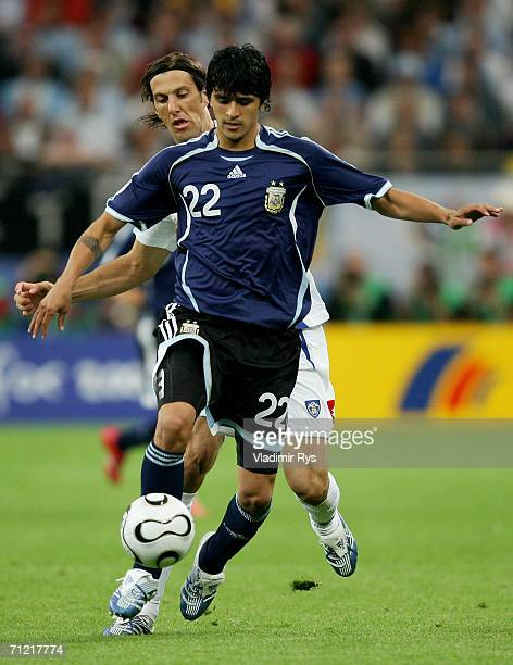 Luis Gonzalez of Argentina battles with Mladen Krstajic of Serbia Montenegro during the FIFA World Cup Germany 2006 Group C match between Argentina...