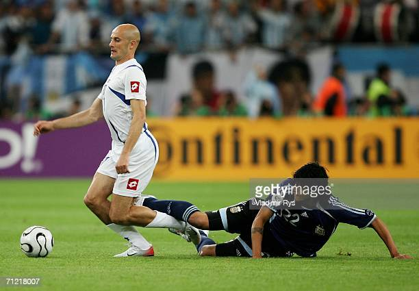 Luis Gonzalez of Argentina battles with Predrag Djordjevic of Serbia Montenegro during the FIFA World Cup Germany 2006 Group C match between...