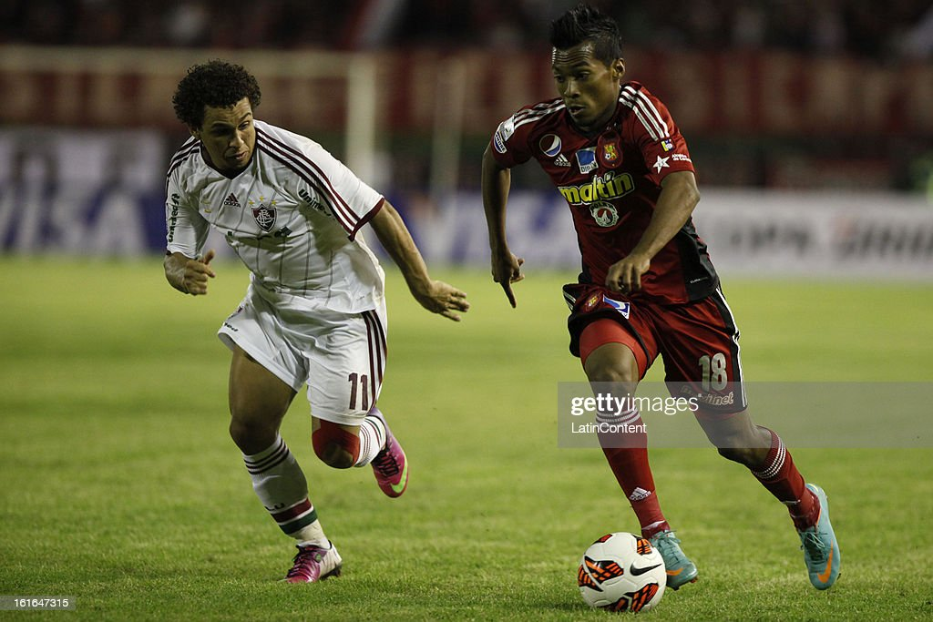 Luis Gonzalez of Caracas FC fights for the ball with Wellington Nem Fluminense during a match between Caracas FC and Fluminense as part of the 2013 Copa Bridgestone Libertadores at the Olympic Stadium on February 13, 2013 in Caracas, Venezuela.
