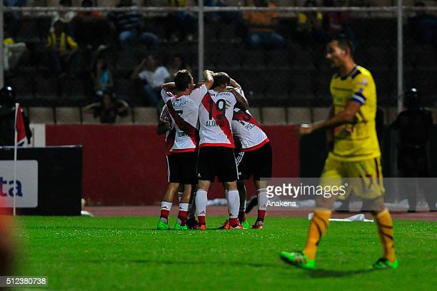Luis Gonzalez of River Plate celebrates with teammates after scoring the second goal of his team during a group stage match between Trujillanos and...