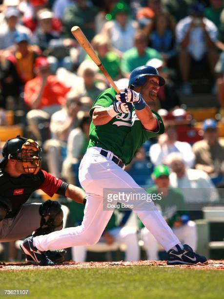 Luis Gonzalez of the Los Angeles Dodgers follows his hit against the Houston Astros during a spring training game on March 17, 2007 at Holman Stadium...