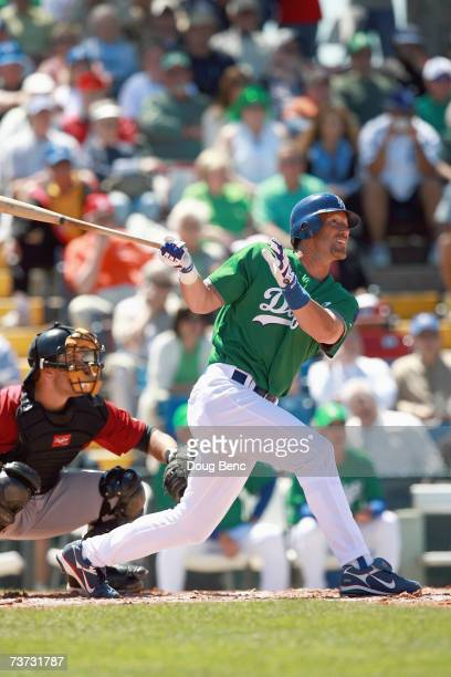 Luis Gonzalez of the Los Angeles Dodgers makes a hit against the Houston Astros during a spring training game on March 17, 2007 at Holman Stadium in...