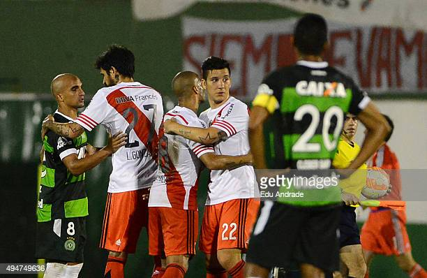 Luis Gonzalez Sebastian Driussi and Carlos Sanchez of River Plate celebrate qualifying to semi finals after a second leg match between Chapecoense...