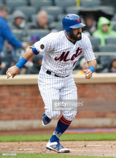 Luis Guillorme of the New York Mets runs to first base during an interleague MLB baseball game against the Toronto Blue Jays during a steady rain on...