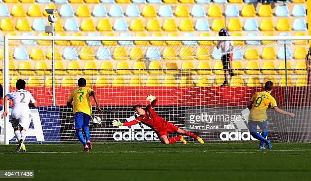 Luis Henrique of Brazil scores his team's winning goal by penalty during the FIFA U17 Men's World Cup 2015 round of 16 match between Brazil and New...