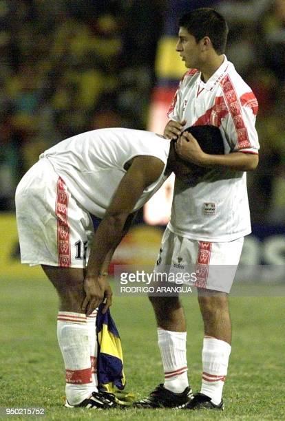Luis Hernandez consoles teammate Santiago Salazar of Peru during their 23 July Copa America quarterfinal match at Centenario Stadium in Armenia...