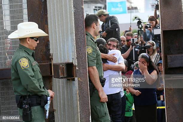 Luis Hernandez hugs his Father Eduardo as they are allowed to meet after a door is opened along the United States Mexico Border wall during Opening...