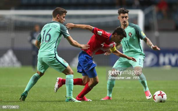 Luis Hernandez of Costa Rica battles with Miguel Luis of Portugal and Helder of Portugal during the FIFA U-20 World Cup Korea Republic 2017 group C...