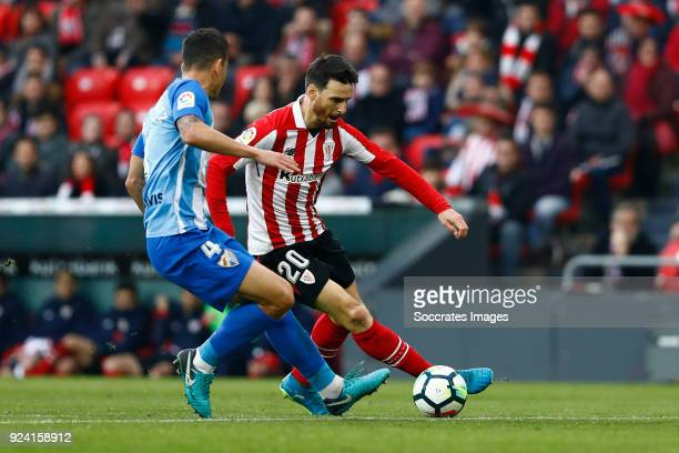 Luis Hernandez of Malaga CF Aritz Aduriz of Athletic Bilbao during the La Liga Santander match between Athletic de Bilbao v Malaga at the Estadio San...