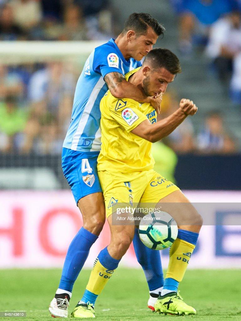 Luis Hernandez of Malaga CF (R) competes for the ball with Jonathan Calleri of Union Deportiva Las Palmas (L) during the La Liga match between Malaga and Las Palmas at Estadio La Rosaleda on September 11, 2017 in Malaga, .