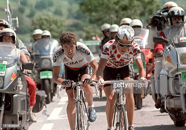 Luis Herrera from Colombia wearing the red and white Polka Dot Jersey of the best climber is followed by Spaniard Pedro Delgado 21 July 1987 during...