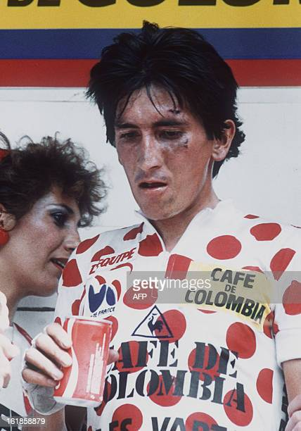 Luis Herrera from Colombia wearing the red and white Polka Dot Jersey of the best climber with wounded face after a fall relaxes 13 July 1985 at the...