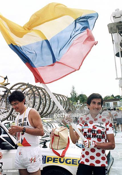 Luis Herrera from Colombia wearing the red and white Polka Dot Jersey of the best climber waves a Colombian flag 20 July 1987 to celebrate his...