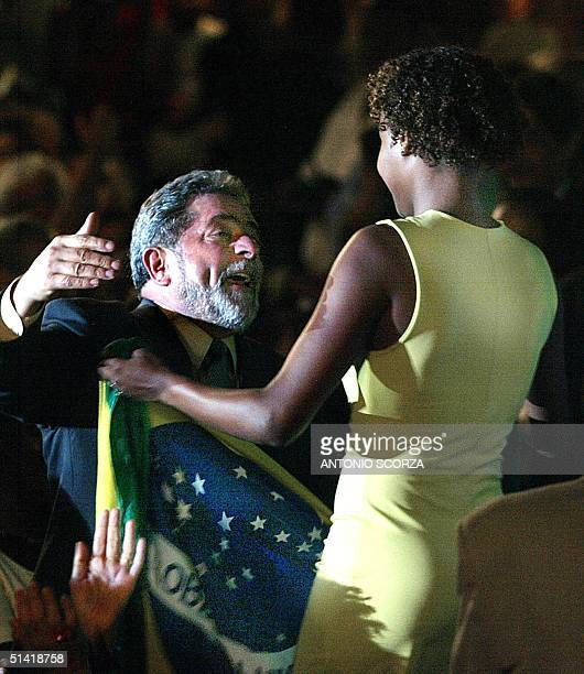 Luis Inacio Lula da Silva presidential candidate of Brazil for the Worker's Party rceives the Brazilian flag from Renata Rodrigues actress of the...