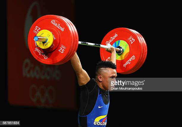 Luis Javier Mosquera Lozano of Colombia competes during the Men's 69kg Group A Weightlifting contest on Day 4 of the Rio 2016 Olympic Games at the...