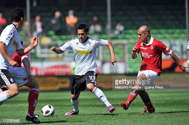 Luis Jimenez of Cesena competes with Sergio Bernardo Almiron of Bari during the Serie A match between AC Cesena and AS Bari at Dino Manuzzi Stadium...