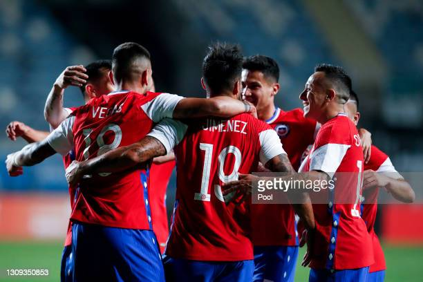 Luis Jimenez of Chile celebrates with teammates after scoring his team's first goal during a friendly match between Chile and Bolivia at El Teniente...