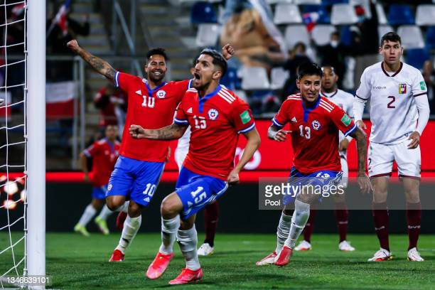 Luis Jiménez, Diego Valdés and Erick Pulgar of Chile celebrate their team's first goal during a match between Chile and Venezuela as part of South...