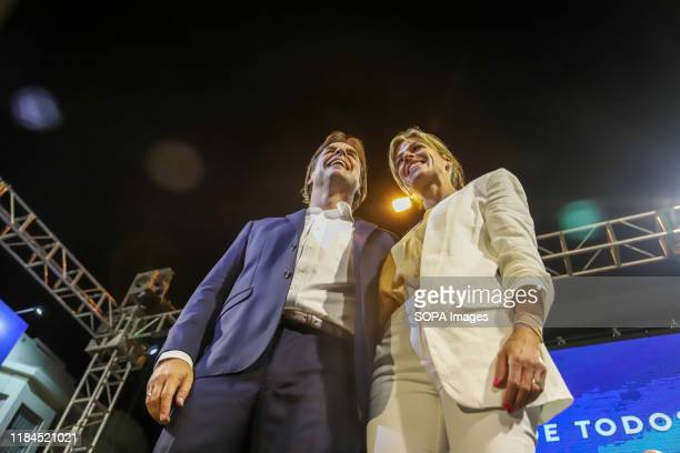 Luis Lacalle Pou, presidential candidate for the National Party and his wife Lorena Ponce de Leon are seen during the event in Montevideo. This...