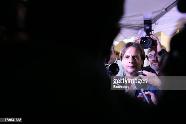 Luis Lacalle Pou presidential candidate for the National Party center listens while speaking with members of the media at the party's headquarters...
