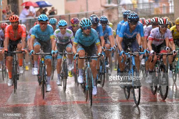 Luis León Sánchez of Spain and Astana Pro Team / Manuele Boaro of Italy and Astana Pro Team / Imanol Erviti Ollo of Spain and Movistar Team / Rain /...