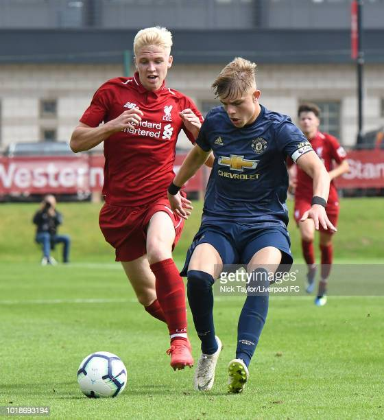 Luis Longstaff of Liverpool and Brandon Williams of Manchester United in action during the Liverpool U18 v Manchester United U18 game at The Kirkby...