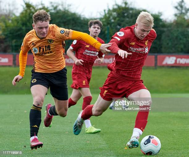 Luis Longstaff of Liverpool and Callum Thompson of Wolverhampton Wanderers in action during the PL2 game at The Kirkby Academy on October 20 2019 in...