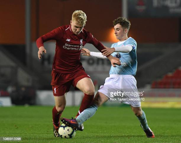 Luis Longstaff of Liverpool and Dan Martin of Accrington Stanley in action during the FA Youth Cup tie at Langtree Park on January 21 2019 in St...