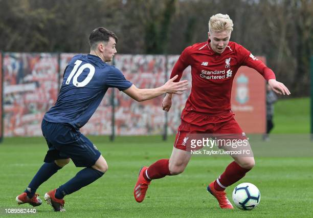 Luis Longstaff of Liverpool and Dylan Levitt of Manchester United in action during the Premier League Cup game at The Kirkby Academy on January 26...