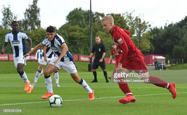 Luis Longstaff of Liverpool and Eoin Ashton of West Bromwich Albion in action during the Liverpool U18 v West Bromwich Albion U18 game at The Kirkby...