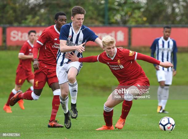 Luis Longstaff of Liverpool and George Harmon of West Bromwich Albion in action during the Liverpool v West Bromwich Albion U18 Premier League game...