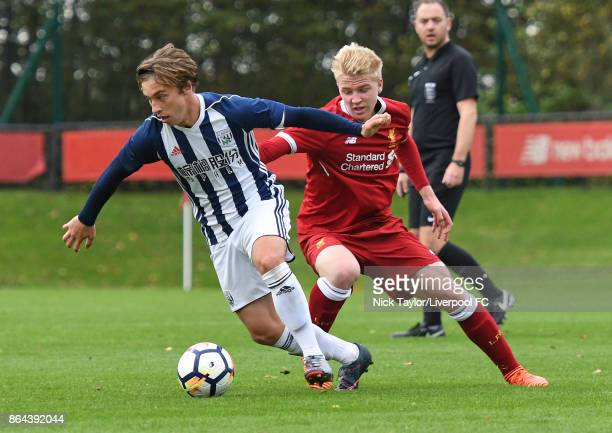 Luis Longstaff of Liverpool and Jack McCourt of West Bromwich Albion in action during the Liverpool v West Bromwich Albion U18 Premier League game at...