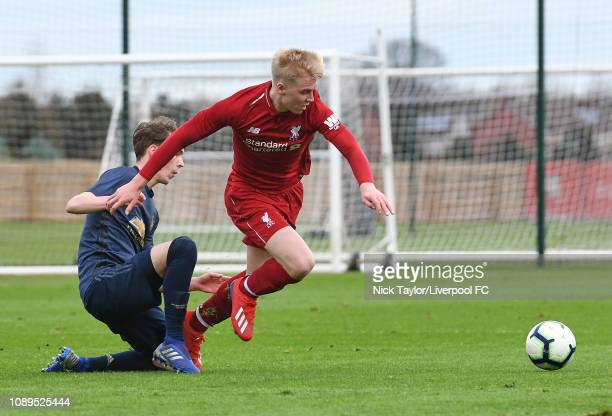 Luis Longstaff of Liverpool and Jimmy Garner of Manchester United in action during the Premier League Cup game at The Kirkby Academy on January 26...