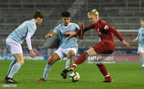 Luis Longstaff of Liverpool and Kason Smith and Adam Bowe of Accrington Stanley in action during the FA Youth Cup tie at Langtree Park on January 21...