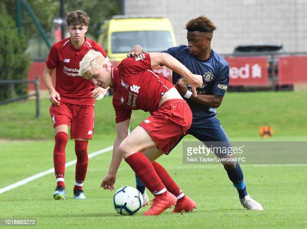 Luis Longstaff of Liverpool and Largie Ramazani of Manchester United in action during the Liverpool U18 v Manchester United U18 game at The Kirkby...