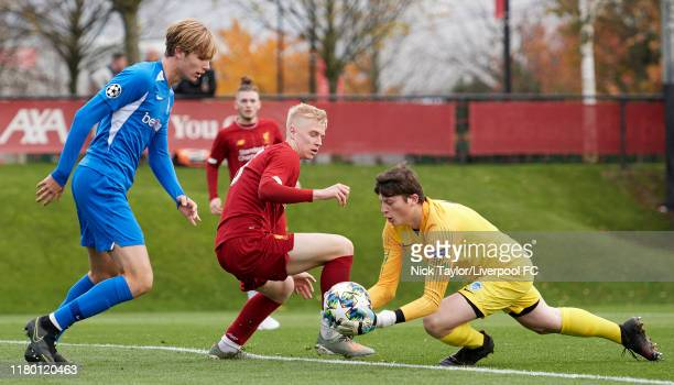 Luis Longstaff of Liverpool and Matisse Didden and Tobe Leysen of Genk in action during the UEFA Youth League game at the Kirkby Academy on November...