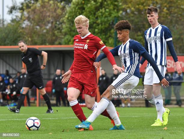 Luis Longstaff of Liverpool and Muio Hau of West Bromwich Albion in action during the Liverpool v West Bromwich Albion U18 Premier League game at The...