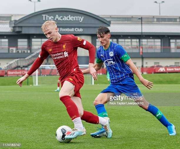 Luis Longstaff of Liverpool and Oliver Crankshaw of Wigan Athletic in action during the Premier League Cup game at The Kirkby Academy on October 6...