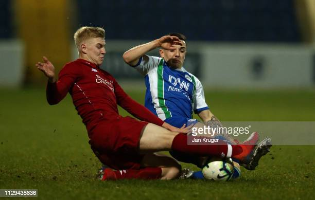 Luis Longstaff of Liverpool and Victor Maffeo of Wigan Athletic challenge for the ball during the FA Youth Cup match between Liverpool and Wigan...