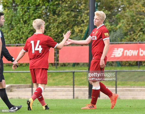 Luis Longstaff of Liverpool celebrates scoring his team's fourth goal with team mate Edvard Sandvik Tagseth during the U18 friendly match between...