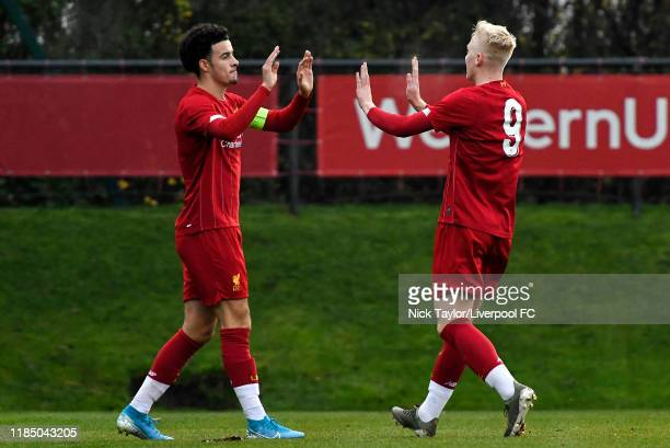 Luis Longstaff of Liverpool celebrates scoring Liverpool's fifth goal with team mate Curtis Jones during the UEFA Youth League game at The Kirkby...